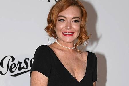In dem Netflix-Film soll Lindsay Lohan eine verwöhnte und frisch verlobte Hotel-Erbin spielen. Foto: Arthur Mola/Invision /AP/dpa