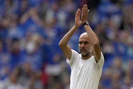 Pep Guardiola will nach eigenen Angaben eine Nationalmannschaft übernehmen. Foto: Alastair Grant/AP/dpa
