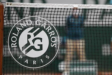 Daniel Altmaier und Laura Siegemund streben in Paris bei den French Open ins Achtelfinale. Foto: Christophe Ena/AP/dpa