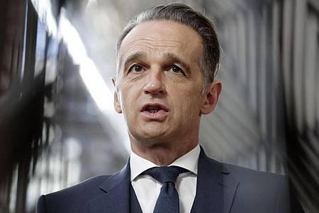 Bundesaußenminister Heiko Maas: «Haben heute einen weiteren Kilometer genommen.». Foto: Olivier Hoslet/Pool EPA/AP/dpa