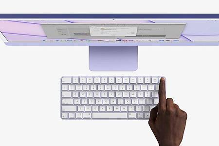 Finger drauf zum Entsperren oder bezahlen. Apples Fingerabdrucksensor Touch ID steckt nun auch im Keyboard der teureren iMac-Modelle. Foto: Apple Inc./dpa-tmn