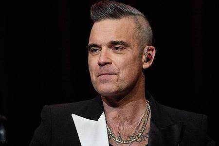 Robbie Williams 2019 in Hamburg bei einem Fankonzert. Foto: Georg Wendt/dpa