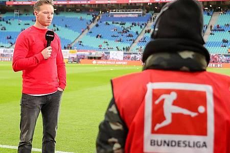 Die Medienpartner der DFL wollen zum Re-Start der Bundesliga besondere Angebote machen. Foto: Jan Woitas/dpa-Zentralbild/dpa
