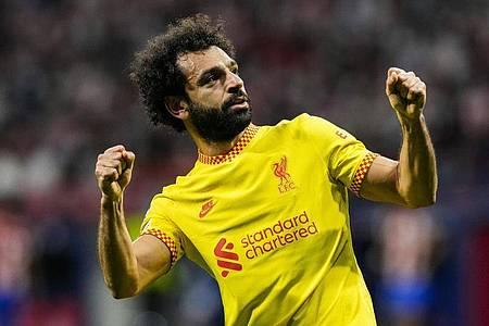 Liverpools Mohamed Salah jubelt nach einem Elfmetertor. Foto: Manu Fernandez/AP/dpa