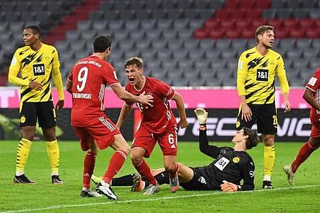 Joshua Kimmich (M) sorgte für den Bayern-Siegtreffer im Supercup gegen den BVB. Foto: Sven Hoppe/dpa-Pool/dpa