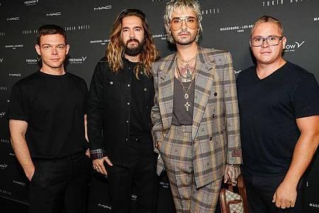 Georg Listing (l-r), Tom Kaulitz, Bill Kaulitz und Gustav Schäfer beim zum Tokio Hotel-Event in Berlin. Foto: Gerald Matzka/dpa