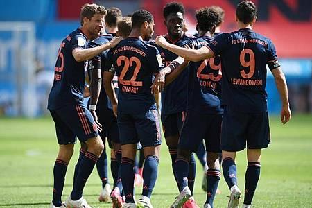 Wollen gegen Eintracht Frankfurt den Einzug ins Pokalfinale fix machen: Die Spieler des FC Bayern München. Foto: Matthias Hangst/Getty Images Europe/Pool/dpa