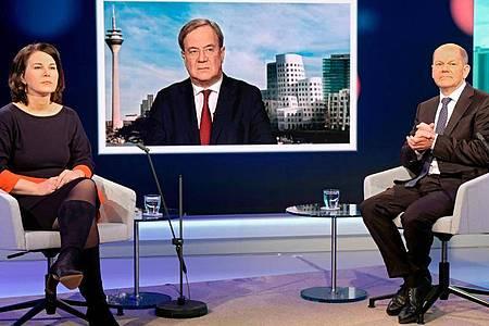 Liegen in jüngsten Umfragen gleich auf: die Kanzlerkandidaten von den Grüne, Union und SPD Armin Laschet, Annalena Baerbock und Olaf Scholz. Foto: Oliver Ziebe/WDR/dpa