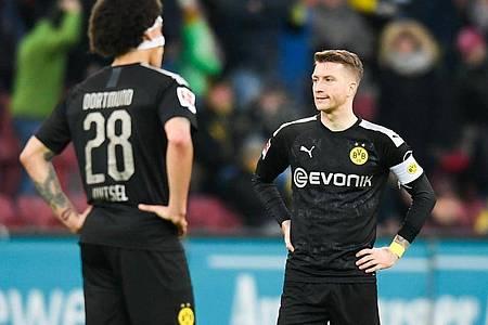Dortmunds Axel Witsel (l) könnte gegen die Bayern zurückkehren, Marco Reus fällt weiter aus. Foto: Tom Weller/dpa