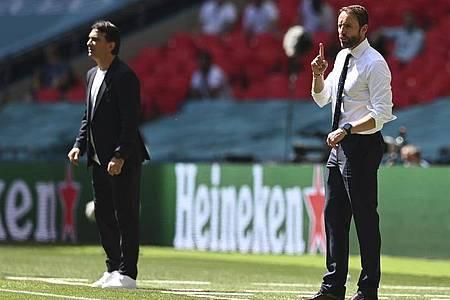Kroatiens Trainer Zlatko Dalic (l) und Englands Trainer Gareth Southgate. Foto: Glyn Kirk/Pool AFP/AP/dpa
