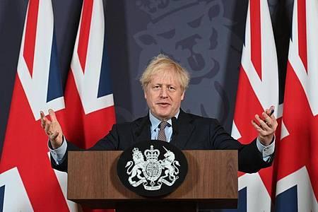 Premierminister Boris Johnson spricht nach dem Durchbruch in den Brexit-Verhandlungen am 24. Dezember bei einer Pressekonferenz in der Downing Street. Foto: Paul Grover/Daily Telegraph/PA Wire/dpa