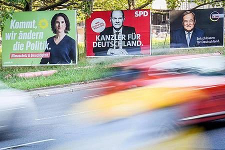 Die drei machen den Wahlsieg unter sich aus:Grünen-Kanzlerkandidatin Annalena Baerbock, die SPD mit Olaf Scholz und die Union mit Armin Laschet als Kanzlerkandidaten. Foto: Kay Nietfeld/dpa