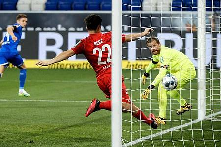 Christoph Baumgartner (2.v.l.) war der Matchwinner beim Hoffenheimer Sieg gegen Köln. Foto: Ronald Wittek/epa-Pool/dpa