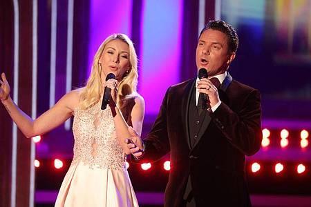 Stefan Mross und Anna-Carina Woitschack singen über die Liebe. Foto: Bodo Schackow/dpa-Zentralbild/ZB