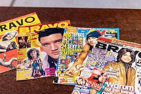 Ausgaben der Bravo mit Marilyn Monroe (l-r), Elvis Presley, Eminem und Michael Jackson auf dem Titel. Foto: Matthias Balk/dpa