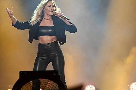 Die Sängerin Helene Fischer kehrt 2022 in München auf die Bühne zurück. Foto: Henning Kaiser/dpa