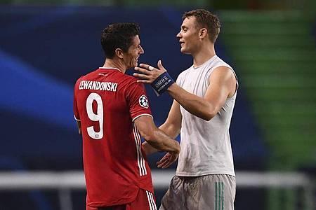 Holten mit Bayern das Triple: Torjäger Robert Lewandowski (l) und Torhüter Manuel Neuer. Foto: Franck Fife/pool AFP/AP/dpa