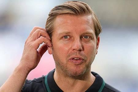 Bleibt Florian Kohfeldt Trainer des SV Werder Bremen. Foto: Friedemann Vogel/EPA/Pool/dpa