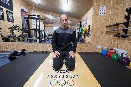 Ringer Frank Stäbler bereitet sich nach seiner Covid-19-Erkrankung unter anderem mit einer Atemtherapie auf die Tokio-Spiele vor. Foto: Marijan Murat/dpa