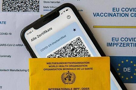 Ende Juni sollen auch Genesene mit Impfung ihren Schutzstatus digital nachweisen können. Foto: Stefan Puchner/dpa