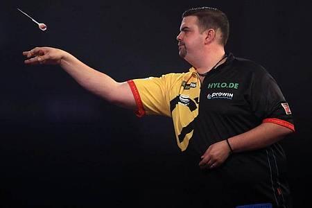 Wirft als einziger Deutscher noch bei der Darts-WM mit: GabrielClemens. Foto: Adam Davy/PA Wire/dpa