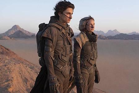 Timothee Chalamet und Rebecca Ferguson in einer Szene aus dem Film «Dune». Foto: Chia Bella James/Warner Bros. Entertainment Inc. via AP/dpa