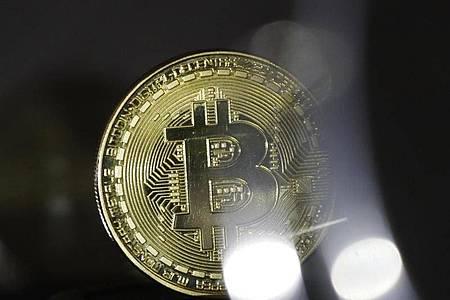 Bitcoins können reich machen - vorausgesetzt, man erinnert sich an sein Passwort. Foto: Ina Fassbender/dpa