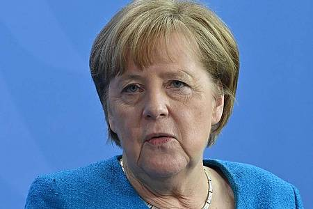 Angela Merkel:«Nach der Pandemie ist vor der Pandemie.». Foto: John Macdougall/AFP-Pool/dpa