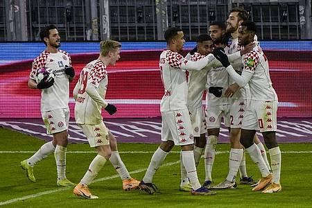 Die Spieler des FSV Mainz 05 zeigten beim FC Bayern einen couragierten Auftritt. Foto: Guenter Schiffmann/AFP-Pool/dpa