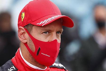 Rennfahrer Sebastian Vettel vom Team Ferrari darf sich auf einer neuen Strecke in Portugal ausprobieren. Foto: Francois Lenoir/POOL REUTERS/AP/dpa