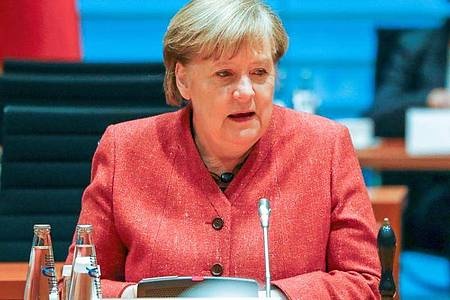 Kanzlerin Angela Merkel bezeichnet die Amtseinführung des neuen US-Präsidenten als «Feier der amerikanischen Demokratie». Foto: Fabrizio Bensch/Reuters/Pool/dpa
