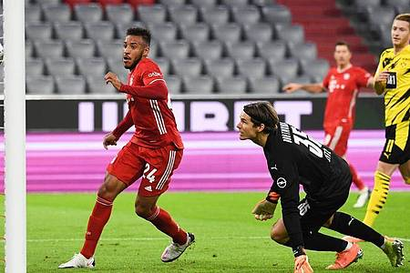 Corentin Tolisso von München (l) brachte die Bayern in Führung. Foto: Sven Hoppe/dpa-Pool/dpa
