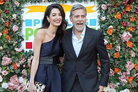 George Clooney und seine Frau Amal 2019 in Edinburgh. Foto: Andrew Milligan/PA Wire/dpa