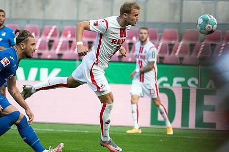 Kölns Sebastian Andersson (M) erzielt das 1:1 gegen Hoffenheim. Foto: Federico Gambarini/dpa