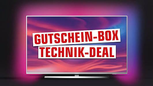 """Fernseher mit Schriftzug """"Gutschein-Box Technik-Deal"""""""