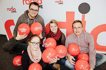 Radio Lippe Team mit Luftballons